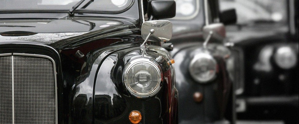 Nearside view of black taxi headlight