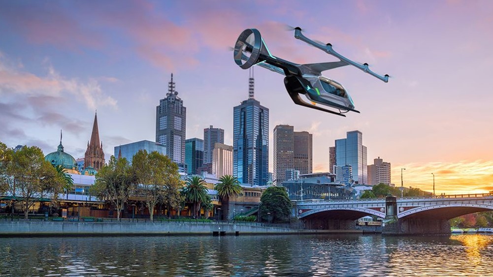 Artist impression of an Uber flying taxi over city