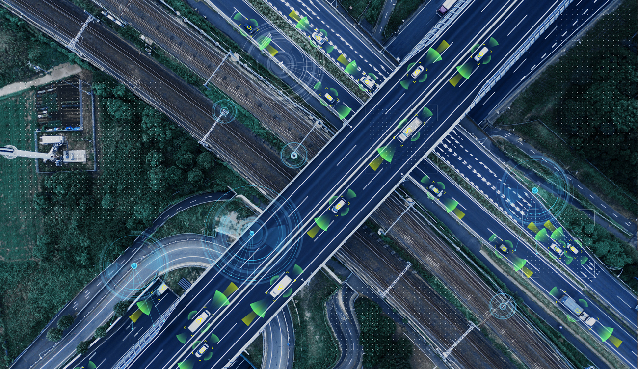 A birds-eye view of a motorway with driverless cars on it and their sensors visible