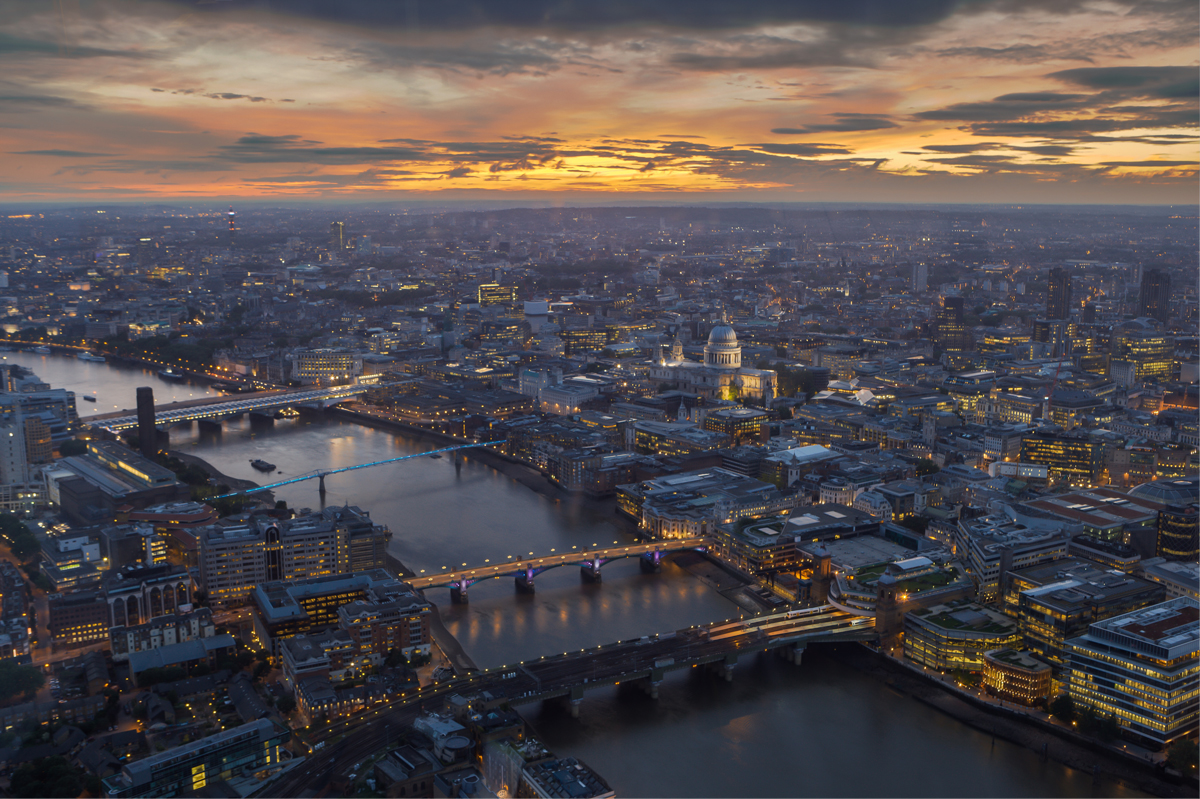 A high up view of the city of London at dusk