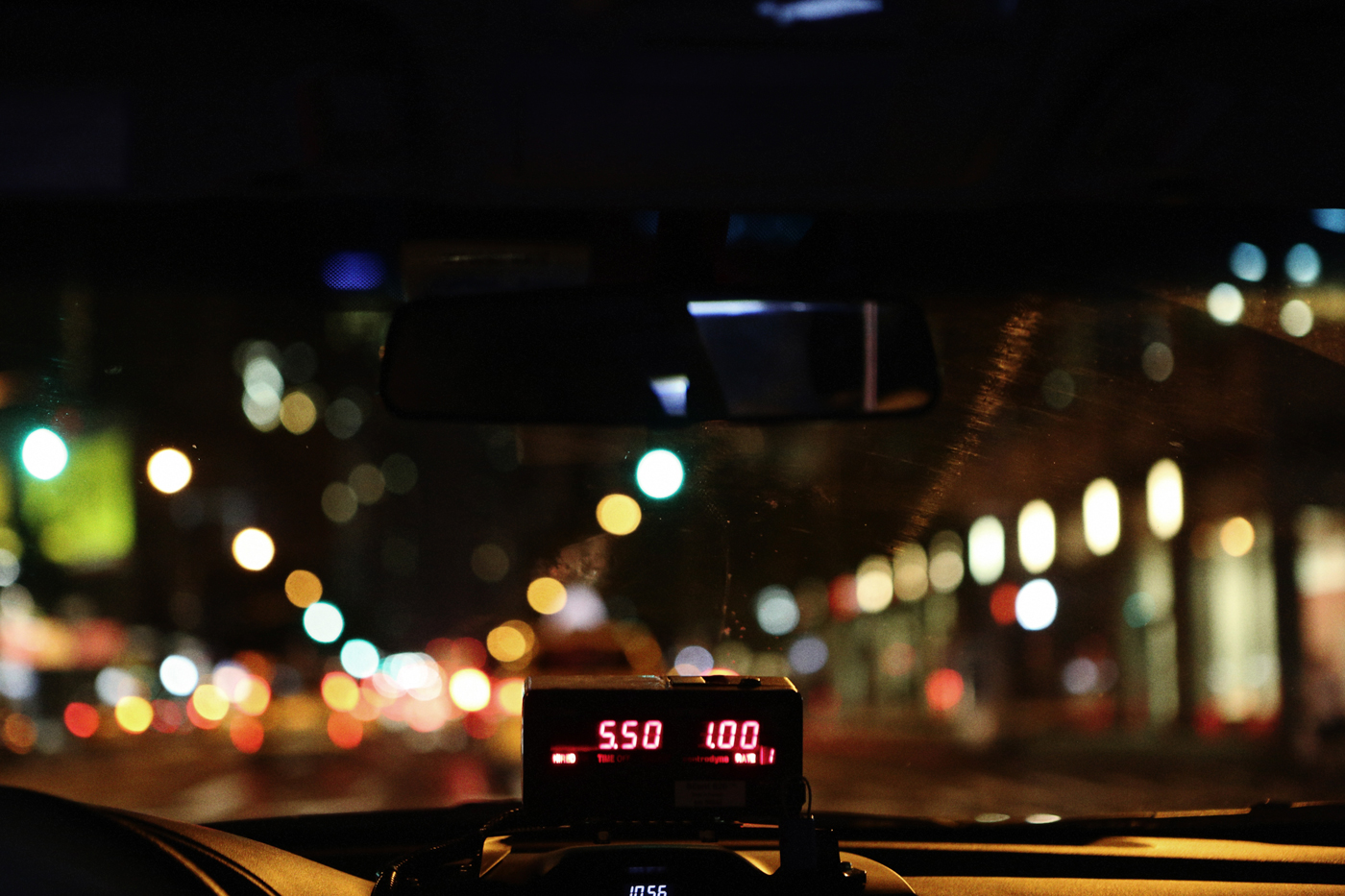 A taxi meter on a dashboard