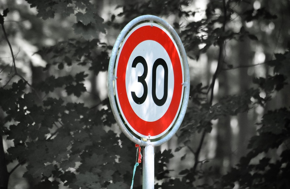 A speed limit road sign