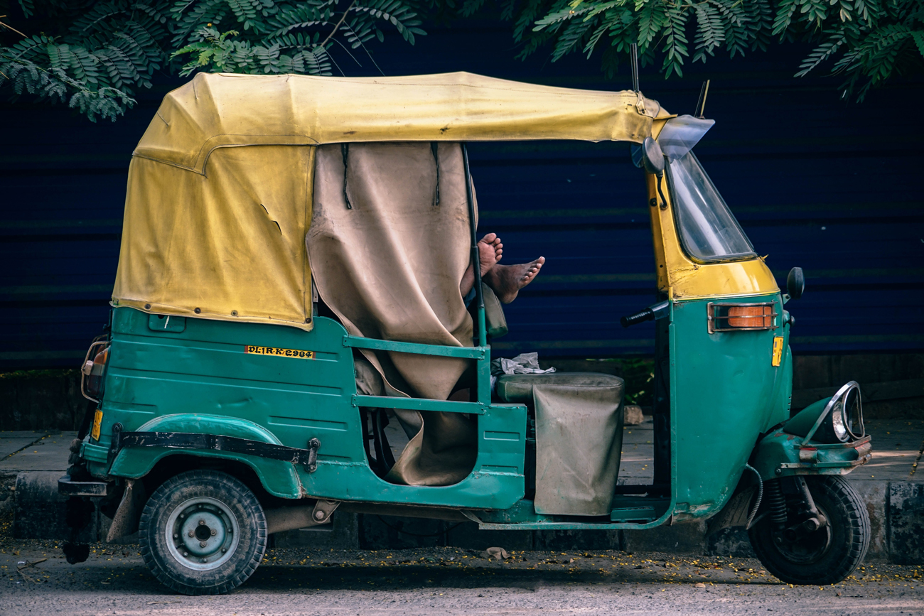 A Rickshaw taxi parked at the side of a road in India