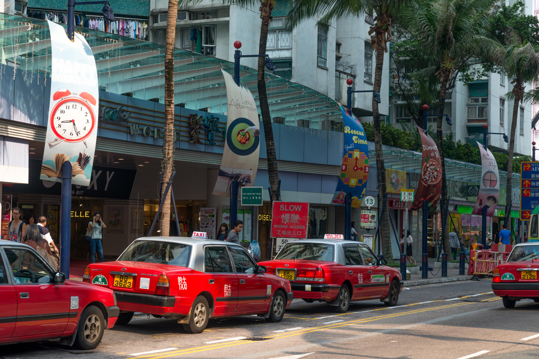 A rank of red taxis in Hong Kong